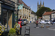 People are walking in Helmsley's town square, Yorkshire, England, United Kingdom.