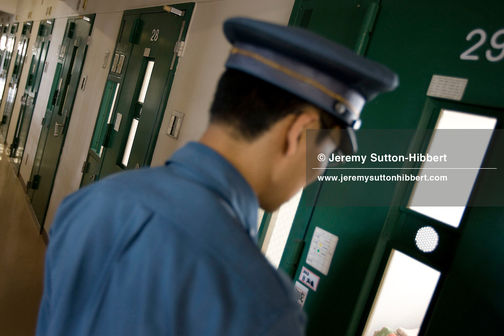 A guard checks the rooms/cells where elderly male prisoners live one to a room, in Onomichi prison, Japan. Monday, May 19th, 2008