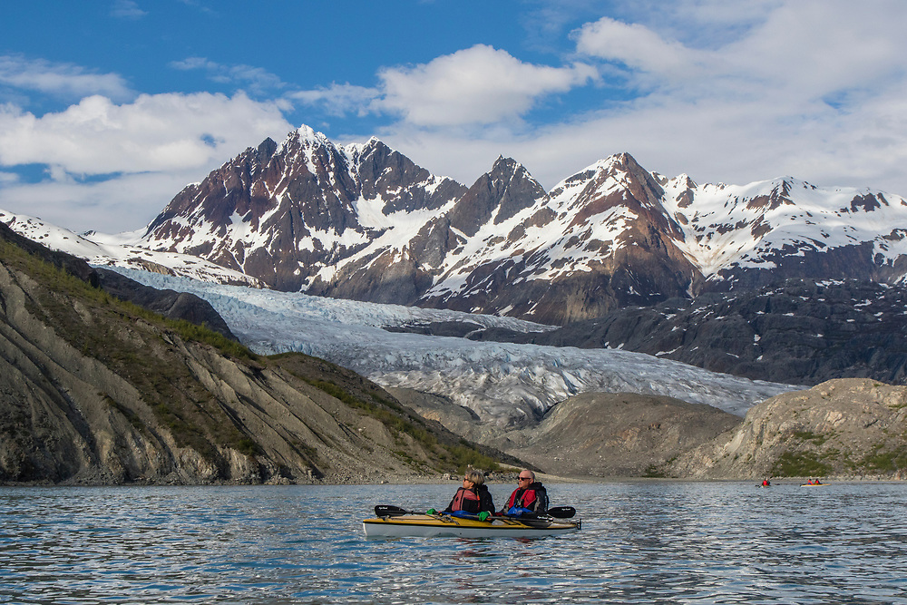 Kayakers rest in front of Riggs Glacier in Glacier Bay.