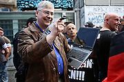 Frankfurt am Main | 20 Jun 2015<br /> <br /> Kundgebung der islamfeindlichen Gruppe &quot;Widerstand Ost West&quot; (WOW) um Ester Seitz, die Rechtspopulisten, rechte Hooligans und Neonazis vereint, auf dem Rossmarkt.<br /> Hier: Der Neonazi Manfred Rouhs filmt.<br /> <br /> Photo &copy; peter-juelich.com