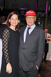 NIKI LAUDA and his wife BIRGIT at the Motor Sport magazine's 2013 Hall of Fame awards at The Royal Opera House, London on 25th February 2013.