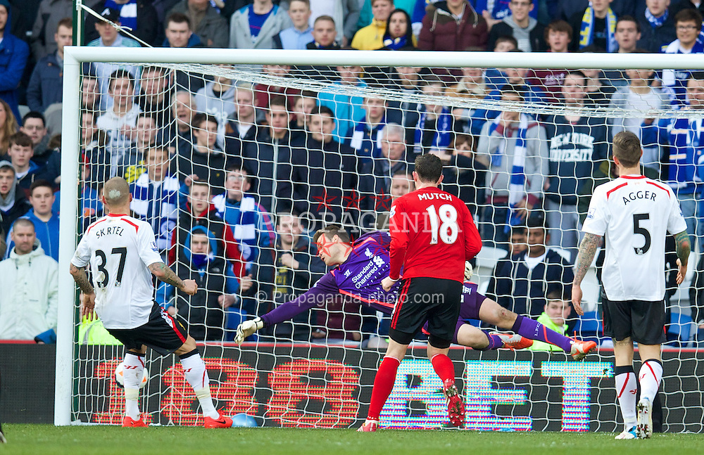 CARDIFF, WALES - Saturday, March 22, 2014: Cardiff City's Jordon Mutch scores the third goal against Liverpool during the Premiership match at the Cardiff City Stadium. (Pic by David Rawcliffe/Propaganda)