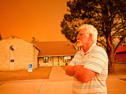02 JUNE 2011 - ALPINE, AZ: Dave Real (CQ) chairman of the board of the Alpine Fire District watches the smoke blow up at the Wallow Fire near Alpine. Real said it's always been a question of when not if a large fire hit Alpine.  High winds and temperatures complicated firefighters' efforts to get the blaze under control. Officials have issued a mandatory evacuation order and residents of the Alpine area had to leave by 8PM Thursday.   PHOTO BY JACK KURTZ