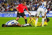 Terence Kongolo of Huddersfield Town (5) and Kamil Grabara of Huddersfield Town (1) collide accidentally during the EFL Sky Bet Championship match between Huddersfield Town and Derby County at the John Smiths Stadium, Huddersfield, England on 5 August 2019.