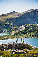 Above it all. Backpackers Alexa Ault, Kaitlyn Honnold, and Chris Call explore Stough Creek Basin, Wind River Range, Wyoming.
