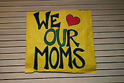 "16440Mom's Weekend Spring 2004 : Photos by Dana..Betsy McEldowney, Jamie Duckworth, ""we love our moms"" poster"