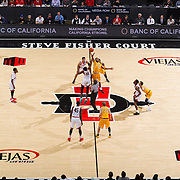 31 January 2017:  The San Diego State Aztecs men's basketball team hosts Wyoming Tuesday night at Viejas Arena. San Diego State forward Malik Pope (21) battles Wyoming forward Jordan Naughton (33) for the tip off. The Aztecs lead the Cowboys 31-27 at half time. www.sdsuaztecphotos.com