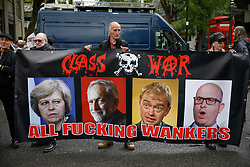 © Licensed to London News Pictures. 01/05/2017. London, UK. Workers and activists hold up a sign showing the faces of the leaders of all four major English political parties, as they gather at Clerkenwell Green in London ahead of a May Day march to Trafalgar Square on May 1, 2017. Photo credit: Tom Nicholson/LNP