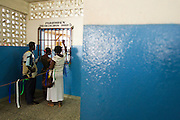 Parents wait to collect their children's prescriptions for free at the Ola During Children's Hospital in Freetown on Tuesday April 27, 2010. The Sierra Leone government announced today the abolition of medical fees for pregnant and lactating women as well as children under the age of 5.