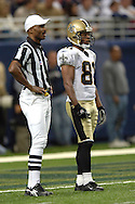 New Orleans kick returner Az-Zahir Hakim (81) stands back at the goal line, waiting along side Referee Mike Carey (L), during game action against St. Louis at the Edward Jones Dome in St. Louis, Missouri, October 23, 2005.  The Rams beat the Saints 28-17.