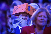 A Wisconsin delegate reacts to one of the speakers as he waits to hear the acceptance speech by Presidential Hopeful Mitt Romney at the GOP National Convention held at the Tampa Bay Forum.