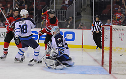 Jan 17; Newark, NJ, USA; New Jersey Devils right wing Petr Sykora (15) scores a goal past Winnipeg Jets goalie Chris Mason (50) during the second period at the Prudential Center.
