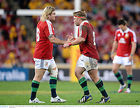 22 June 2013; Tom Youngs, British & Irish Lions, right, is replaced by team-mate Richard Hibbard during a second half substitution. British & Irish Lions Tour 2013, 1st Test, Australia v British & Irish Lions, Suncorp Stadium, Brisbane, Queensland, Australia. Picture credit: Stephen McCarthy / SPORTSFILE
