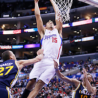 23 October 2013: Los Angeles Clippers center Ryan Hollins (15) dunks past Utah Jazz center Rudy Gobert (27) and Utah Jazz point guard Alec Burks (10) during the Los Angeles Clippers 103-99 victory over the Utah Jazz at the Staples Center, Los Angeles, California, USA.