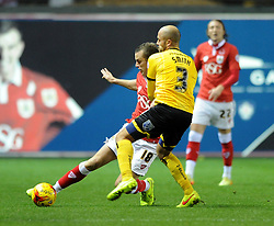 Bristol City's Aaron Wilbraham is challenged by Wimbledon's Jack Smith - Photo mandatory by-line: Dougie Allward/JMP - Mobile: 07966 386802 - 11/11/2014 - SPORT - Football - Bristol - Ashton Gate - Bristol City v AFC Wimbledon - Johnstone Paint Trophy
