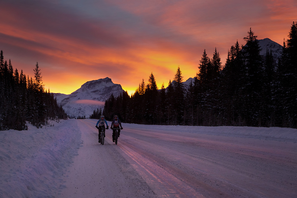 Biking at sunrise on the Icefields Parkway, Banff National Park, Cancadian Rockies, Alberta, Canada