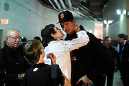 San Francisco Giants starter Randy Johnson gets a kiss from his sister Sue after earning his 300th career win in a victory over the Washington Nationals in their National League MLB baseball game in Washington, June 4, 2009.