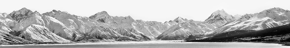 A very large panoramic (comprised of 20 separate images) of snow blanketing Mount Cook and the Southern Alps.  From left to right, the Ben Ohau Range continues to the Sealy Range, then to Mount Cook Range, and then the Burnett Mountains.