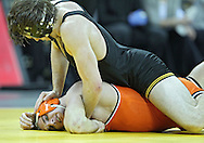 January 07, 2011: Iowa's Mike Evans holds down Oklahoma State's Dallas Bailey during the 165-pound bout in the NCAA wrestling dual between the Oklahoma State Cowboys and the Iowa Hawkeyes at Carver-Hawkeye Arena in Iowa City, Iowa on Saturday, January 7, 2012. Evans won 5-1.