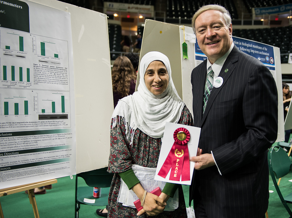 Hebaallaha Hussein poses for a picture with Ohio University President Duane Nellis during the 2018 Student Research Expo.