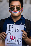 20 MAY 2014 - BANGKOK, THAILAND: A Thai man protests the Thai army declaration of martial law. About 200 Thais gathered at the Bangkok Art and Culture Centre in central Bangkok to protest the army's decision to impose martial law.   PHOTO BY JACK KURTZ