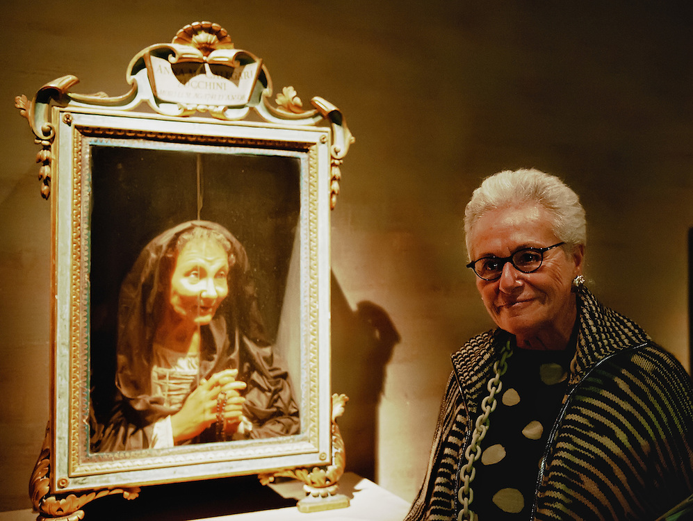 "VENICE, ITALY - MARCH 09:  Stylist Mariuccia Missoni poses for a picture next to a 17 Century wax portrait during  the press preview of ""Avere Una Bella Cera - Wax Portraits Exhibition"" at Palazzo Fortuny on March 9, 2012 in Venice, Italy.  The exhibition open until June 25 is the world's first exhibition on wax portraits analizing a field that has been studied very little by art historians."