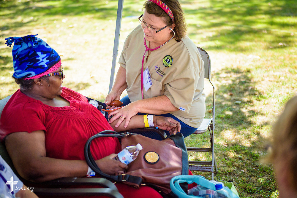 Sharon Thomas, a nurse from Belvidere, Ill., and chairman of the board of Lutherans in Medical Missions, takes a blood pressure reading from visitor Michele Walker at the first domestic Mercy Medical Team on Friday, Aug. 26, 2016, at Shepherd of the City Lutheran Church in Philadelphia. LCMS Communications/Erik M. Lunsford