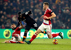 Adama Diomande of Hull City is tackled by Ben Gibson of Middlesbrough - Mandatory by-line: Robbie Stephenson/JMP - 05/12/2016 - FOOTBALL - Riverside Stadium - Middlesbrough, England - Middlesbrough v Hull City - Premier League