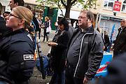 Frankfurt am Main | 26 Apr 2014<br /> <br /> Am Samstag (26.04.2014) veranstalten Aktivisten der rechtspopulistischen AfD (Alternative f&uuml;r Deutschland) auf der Leipziger Stra&szlig;e in Frankfurt-Bockenheim einen Infostand, sie versuchen, Infomaterial und Flugbl&auml;tter an Passanten zu verteilen, um f&uuml;r die Partei im laufenden Europawahlkampf zu werben.<br /> Die AfD-Wahlk&auml;mpfer werden durchgehend von etwa 50 linksradikalen Aktivisten gest&ouml;rt und behindert.<br /> hier: Der Frankfurter AfD-Aktivist Hans-Peter Brill (im Regionalvorstand der Partei) versteckt sich hinter Polizeibeamten vor den Gegendemonstranten. <br /> <br /> &copy;peter-juelich.com<br /> <br /> [No Model Release | No Property Release]