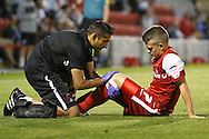 Picture by David Horn/Focus Images Ltd +44 7545 970036.21/08/2012.Dean Cox of Leyton Orient receives treatment during the npower League 1 match at the Matchroom Stadium, London.