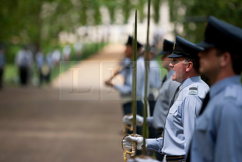 © Licensed to London News Pictures. 27/06/2012. LONDON, UK. Members of the RAF take part in a rehearsal for the opening ceremony of the newly built RAF Bomber Command memorial in Green Park London today (27/06/12). The memorial commemorates the 55,573 airmen lost flying bomber aircraft during the Second World War and will be opened officially by the Queen on the 28th of June.  Photo credit: Matt Cetti-Roberts/LNP
