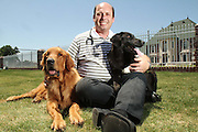 """Blind Dog has its own Guide Dog<br /> Tulsa, Oklahoma, USA - Tanner, a blind Golden Retriever suffering from epilepsy, has his own seeing-eye dog. """"It sounds incredible, but it's true,"""" said Dr. Mike Jones, director of the Woodland West Animal Hospital in Tulsa, Oklahoma. """"Tanner and Blair, a one-year-old black Labrador met at our facility and Blair grabbed hold of Tanner's leash and began leading him around.""""<br /> (Credit Image: © James Gibbard/Exclusivepix)"""