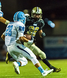 Corona Del Mar Sea Kings Anthony Battista (28) runs while Dayton Weems (36) of Laguna Hills Hawks tries to intercept.