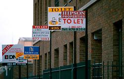 IRELAND DUBLIN MAR00 - Estate Agents signs are bolted to the wall of a new Docklands development project in Dublin's North. .. jre/Photo by Jiri Rezac. . © Jiri Rezac 2000. . Tel:   +44 (0) 7050 110 417. Email: info@jirirezac.com. Web:   www.jirirezac.com