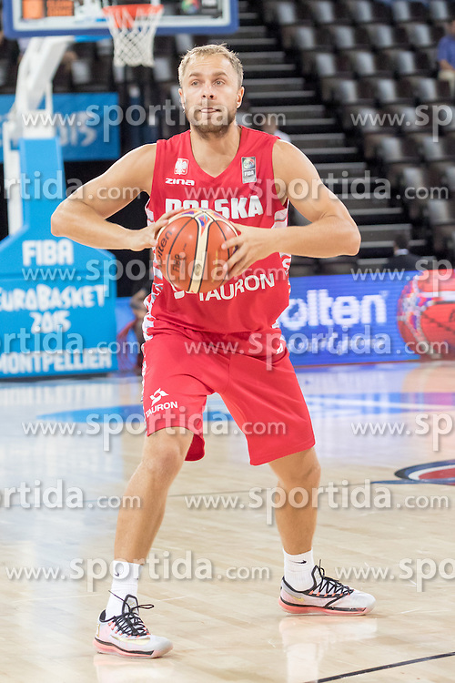 06.09.2015, Park Suites Arena, Montpellier, FRA, Russland vs Polen, Gruppe A, im Bild LUKASZ KOSZAREK (15) // during the FIBA Eurobasket 2015, group A match between Russia and Poland at the Park Suites Arena in Montpellier, France on 2015/09/06. EXPA Pictures &copy; 2015, PhotoCredit: EXPA/ Newspix/ Pawel Pietranik<br /> <br /> *****ATTENTION - for AUT, SLO, CRO, SRB, BIH, MAZ, TUR, SUI, SWE only*****
