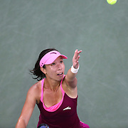 Jie Zheng, China, in action against Carla Suarez Navarro, Spain, during the Women's Singles competition at the US Open. Flushing, New York, USA. 30th August 2013. Photo Tim Clayton