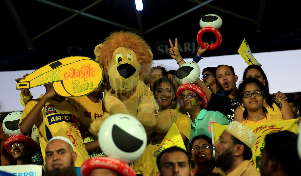 Fan's enjoys during match 17 of the Pepsi Indian Premier League 2014 between the Sunrisers Hyderabad and the Chennai Superkings held at the Sharjah Cricket Stadium, Sharjah, United Arab Emirates on the 27th April 2014<br /> <br /> Photo by Sandeep Shetty / IPL / SPORTZPICS