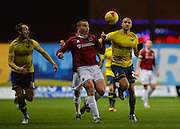 Northampton Town Defender Rodney McDonald and Oxford United Forward Jordan Bowery during the Sky Bet League 2 match between Oxford United and Northampton Town at the Kassam Stadium, Oxford, England on 16 February 2016. Photo by Adam Rivers.