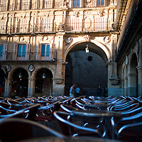Reflections on the metallic surface of the restaurant tables, Plaza Mayor, Salamanca, Castilla y Leon, Spain