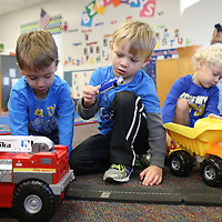 Lauren Wood | Buy at photos.djournal.com<br /> Thomas McCory, 4, from left, Miller Gardner, 3, and Sam Abraham, 4, plays with cars and trucks Thursday morning at the NMMC Child Care Center.