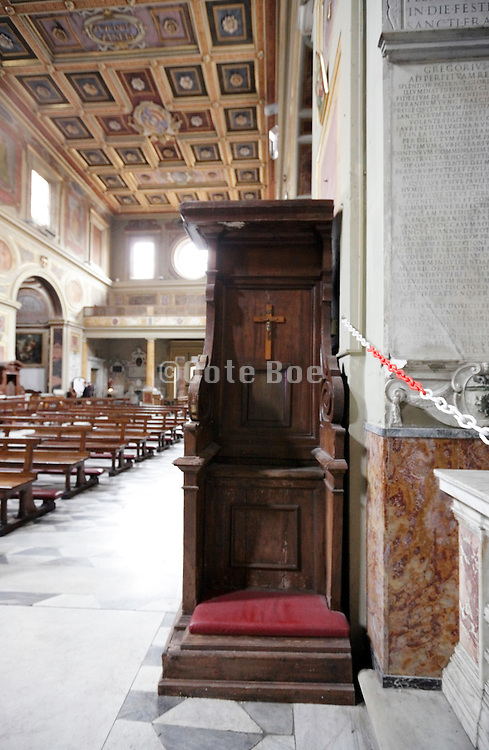 confessional with Jesus and cross
