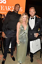 Left to right, ANTHONY JOSHUA, CAMILLA KERSLAKE and CHRIS ROBSHAW at the GQ Men of The Year Awards 2016 in association with Hugo Boss held at Tate Modern, London on 6th September 2016.