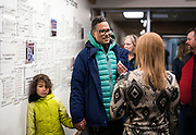 Brian Benford speaks with an Operation Fresh Start staff member during the grand opening ceremony for Operation Fresh Start on Milwaukee Street in Madison, WI on Thursday, April 11, 2019.