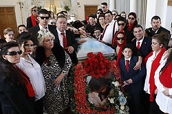 © Licensed to London News Pictures. 21/04/2018. Cobham, UK. Paddy <br /> Doherty (r) and family members stand at the coffin of their mother Queenie, Elizabeth Doherty at Sacred Heart Church in Cobham, Surrey. Elizabeth Doherty, whose son Paddy Doherty is known for appearing on My Big Fat Gypsy Wedding and winning Celebrity Big Brother 8, died of a heart attack earlier this month. Paddy Doherty claimed his mother has died of a 'broken heart' following the death of her husband almost a year ago. Photo credit: Peter Macdiarmid/LNP