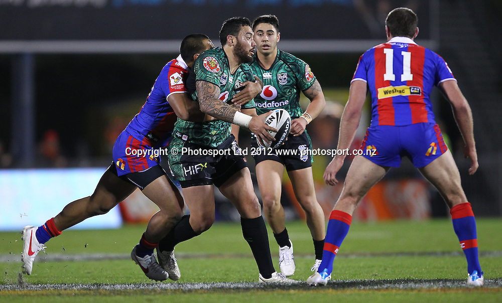 Feleti Mateo of the Warriors looks to pass during the NRL game, Vodafone Warriors v Newcastle Knights, Mt Smart Stadium, Auckland, Saturday 21st July 2012. Photo: Simon Watts /photosport.co.nz