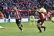 Sheffield United player Kieron Freeman (18) celebrates scoring goal  with Sheffield United forward Billy Sharp (10) to go  1-0 and win match during the EFL Sky Bet League 1 match between Sheffield Utd and Northampton Town at Bramall Lane, Sheffield, England on 31 December 2016. Photo by Ian Lyall.