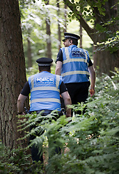 © Licensed to London News Pictures. 23/06/2017. Dorking, UK. Police patrol as workers dismantle a protest fort built over an oil well site near Leith Hill in the North Downs . Protestors have been evicted from the camp over the last few days. Planning permission for 18 weeks of exploratory drilling was granted to Europa Oil and Gas in August 2015 after a four-year planning battle. The camp was set up by protestors in October 2016 in order to draw attention to plans to drill in this Area of Outstanding Natural Beauty (AONB) in the Surrey Hills. The camp has received support from the local community. Photo credit: Peter Macdiarmid/LNP