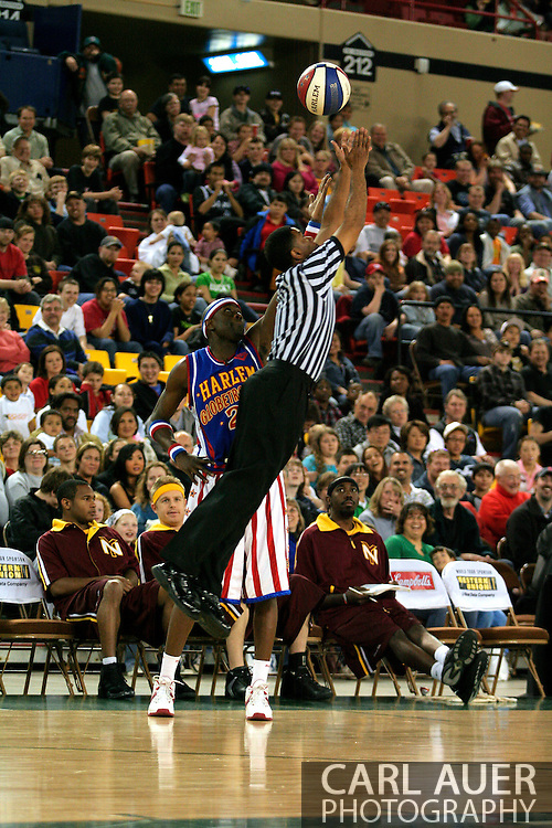 """04 May 2006: Kevin """"Special K"""" Daley, the Crown Prince of Basketball plays keep away with the referee during the Harlem Globetrotters vs the New York Nationals at the Sulivan Arena in Anchorage Alaska during their 80th Anniversary World Tour.  This is the first time in 10 years that the Trotters have visited Alaska."""