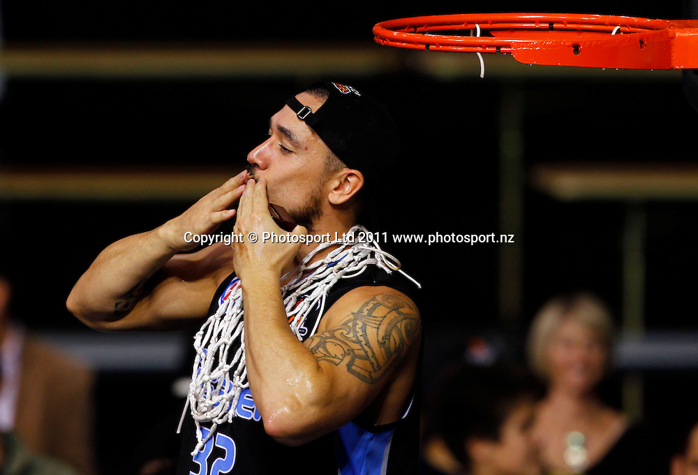 Breakers captain Paul Henare cuts the net after victory over the Cairns Taipans during the ANBL Grand Finals Game 3, Burger King Breakers v Cairns Taipans at the North Shore Event Centre Auckland, New Zealand on Friday 29 April 2011. Photo: Simon Watts/photosport.co.nz