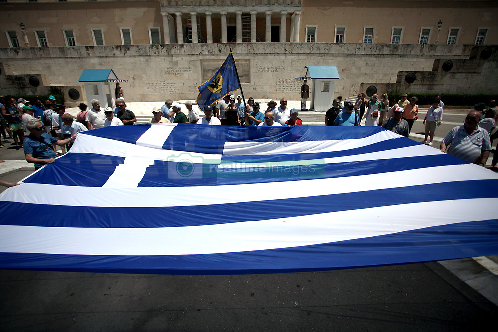 June 14, 2018 - Athens, Greece - Anti-austerity rally in Athens. Greece's parliament approved the last big austerity package of its eight-year bailout program Thursday, preparing the country for its full return to financing itself on bond markets beginning this summer.. (Credit Image: © Giorgos Georgiou/NurPhoto via ZUMA Press)